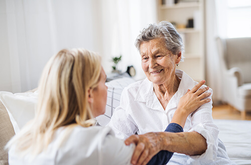 Home Care Provider Embracing Patient