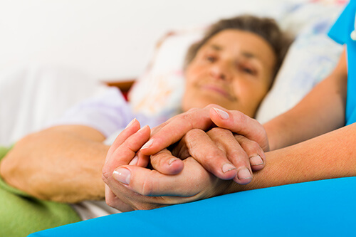 Home Care Provider Comforting Patient